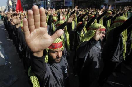 Militantes do grupo libanês Hezbollah. Foto: Sharif Karim / Reuters